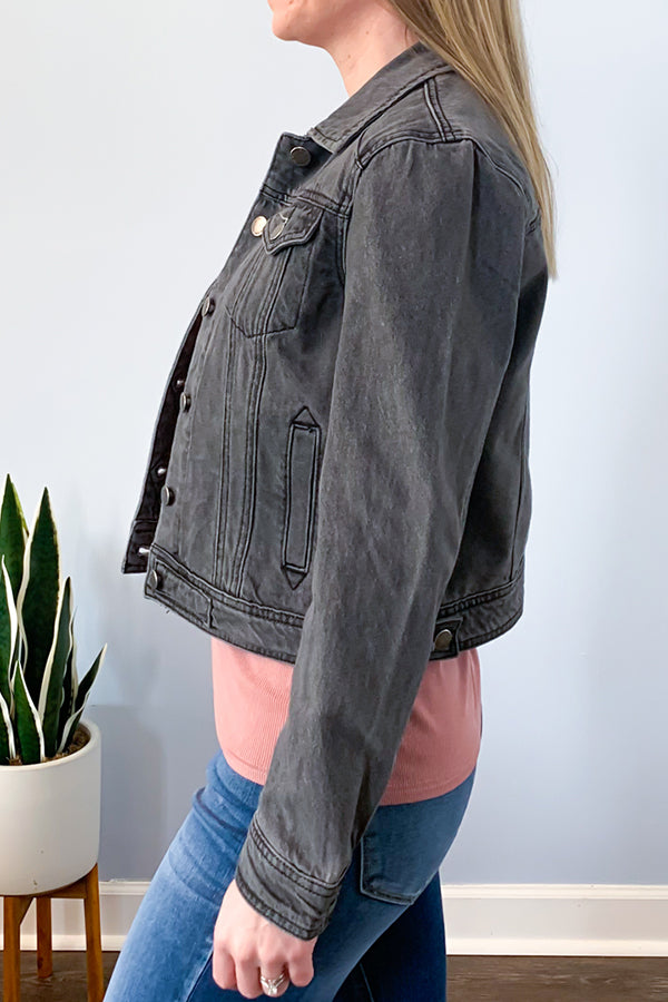 Our Vintage Grey Denim Jacket is the perfect-fitting crop jean jacket! Featuring top-of-the-line denim, contrast top stitching, pockets, and button closure. This is just one of those staple pieces your closet needs.  Pair with a fun graphic tee and skinny jeans for a fun, casual outfit.  Throw on over a maxi dress and wedges for a cute spring-time outfit. Velvet Heart.