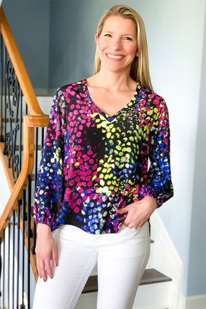 OMG! Veronica M does it again with bringing us the most beautiful blouses.  The Alvaro Bubble Sleeve V-Neck Blouse features a colorful abstract print with bright shades of blue, yellow, and pink.  You're sure to get compliments on this gorgeous blouse.  This flattering top features a v-neckline, bubble sleeves with elastic cuffs, and a hi-low hem.  Pair with white skinny jeans for a spring dinner outfit.