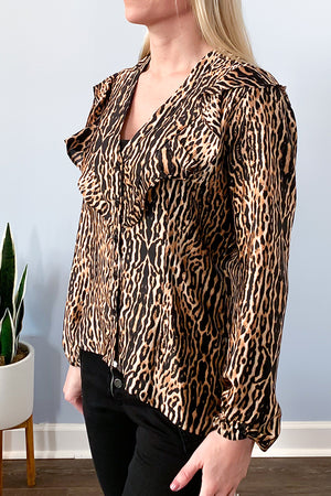 The Animal Print Long Sleeve Ruffle Blouse features a black base with brown and gold tone animal inspired print.  Flattering v-neckline with ruffle details give this button up blouse a unique look.  Made with a soft, satin-like material.  The elastic cuffs make it easy to wear as a 3/4 sleeve style or long sleeve style.  This high-quality blouse is perfect for adding a pop of style to your work outfit.  Pair with some black skinny jeans and cute booties for a night-out outfit. Veronica M Clothing.
