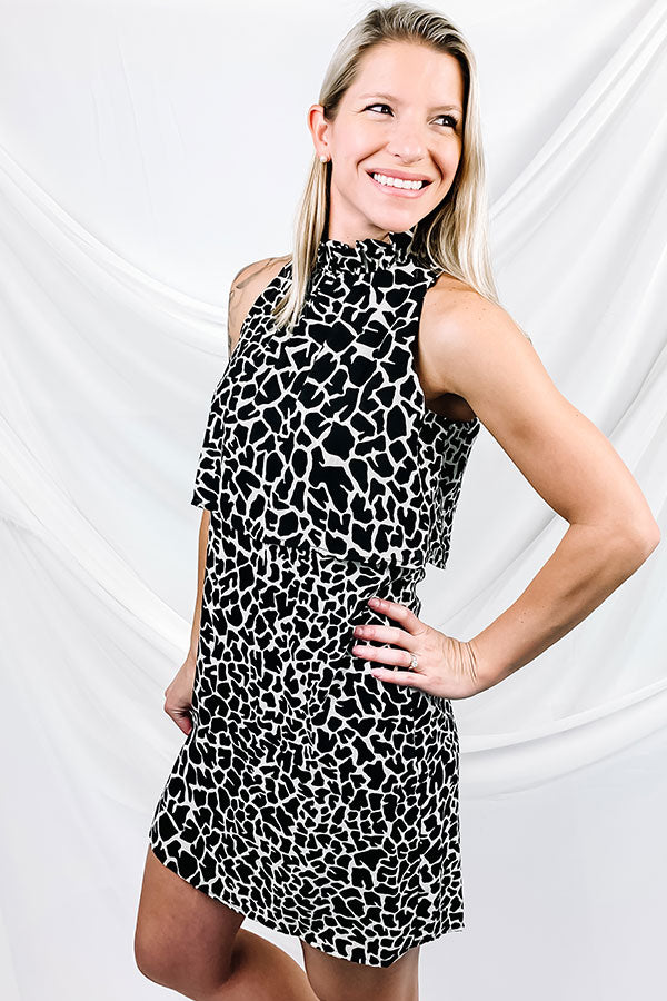 This Black/White Mosaic High Neck Dress is a personal favorite.  Black and white mosaic print make this dress stand out from the crowd.  High neck style with ruffle detailing and button closure.  This is the perfect date night dress you've been searching for.  Veronica M Dress