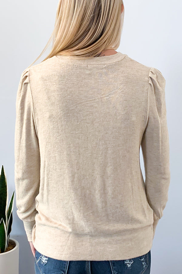 Veronica M Long Sleeve Twisted Knot Front Sweater. The Long Sleeve Twisted Knot Front Sweater will keep you warm during this fall season.  This ultra-soft sweater features a round neckline, slightly puffed sleeves, fitted cuffs, and twisted front detail.  The sand colored, stretchy fabric make this a comfy and cozy sweater.  I love this top paired with a high-waist skinny jean and pair of booties.  This lightweight sweater will be perfect for layering.