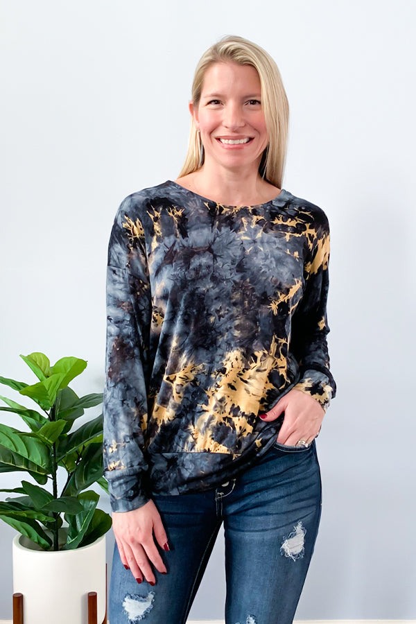 Feel comfortable while lounging in our Navy Tie-Dye Open Back Dolman Top.  This trendy tie dye top features long dolman sleeves, scoop neckline, and a cute open back.  This soft and stretchy top is perfect for dressing up or dressing down.  This top is true to size but size up if you want a looser fit.