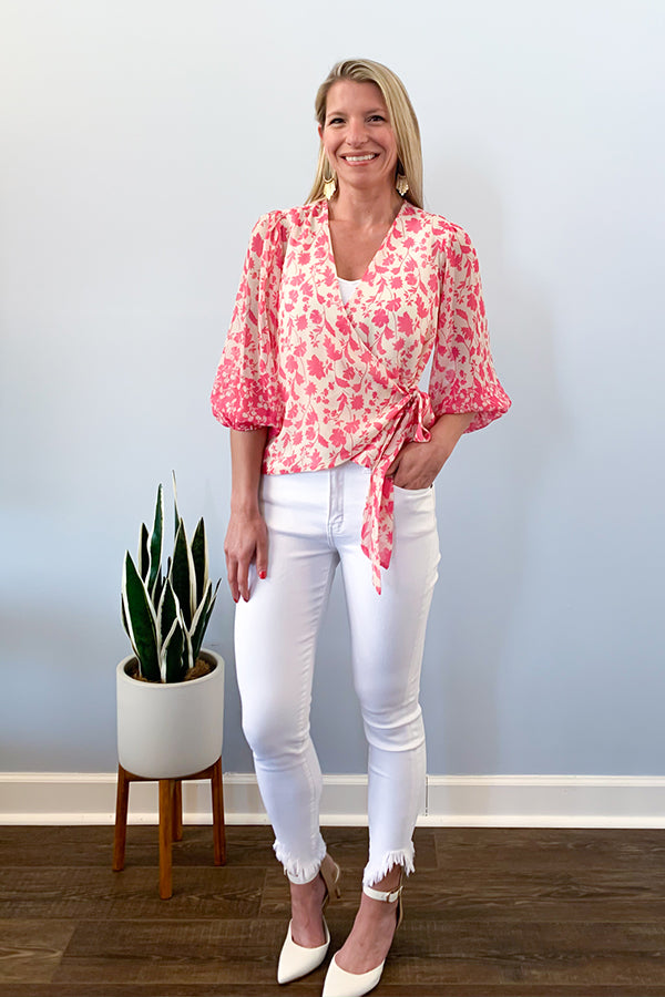 "Pink Floral Puff Sleeve Wrap Blouse By Veronica M  Details  Pink Floral Print Wrap Style Puff Sleeves With Elastic Cuffs V Neckline Side Tie Front Side Lined Back Side Unlined / Sheer Veronica M Cassia 100% Polyester Care: Machine Wash Made in U.S.A. Model is 5'4"" and wearing an extra small"