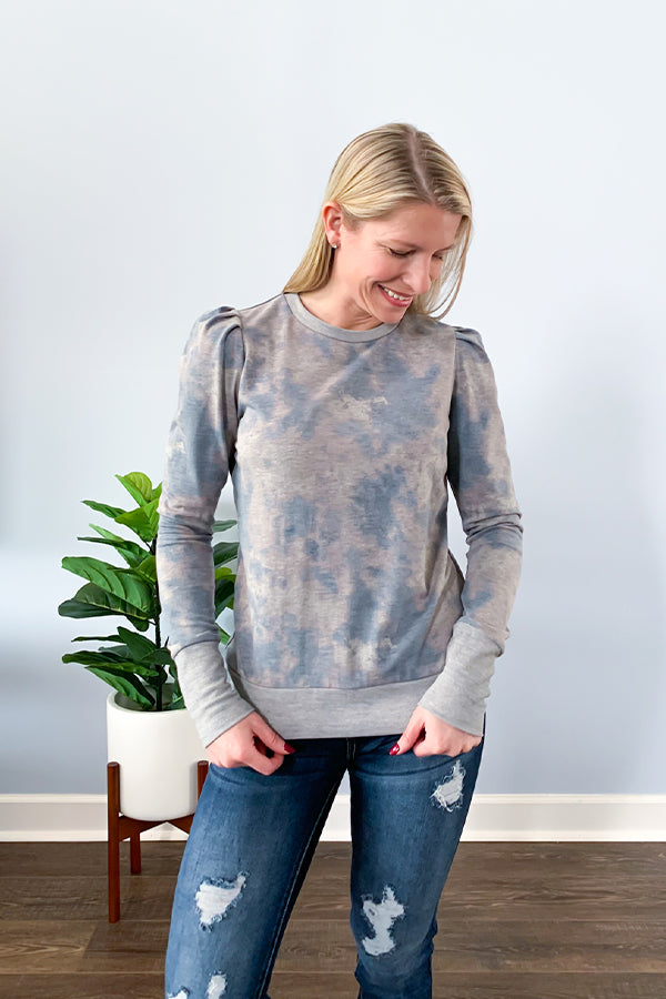 Puff sleeves are definitely trending this fall and we are loving it. Our Puff Sleeve Tie Dye Sweater is the perfect cozy sweater for you. Fun, feminine puff sleeves in a trendy tie dye print with contrast cuff and waistline hem. This is the perfect, cozy, sweater you've been looking for. Stand out from the rest! Pair with your favorite jeans and cute booties for the perfect fall outfit.