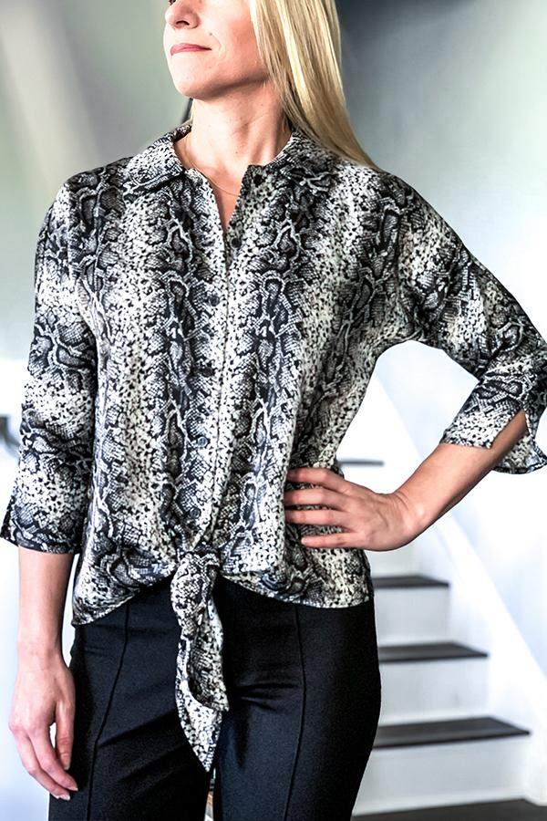 Veronica M Snake Print Satin Blouse With Front Tie Button down blouse with collar 3/4 length sleeve Side slit detail on sleeve Front tie detail Snake print Colors: black, grey, and white Satin like fabric 100% Polyester Machine wash Made in U.S.A.