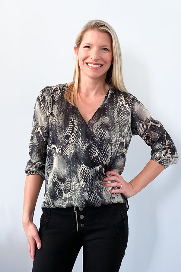 Veronica M blouse | The Snake Print Surplice Blouse features a v-neckline, high-low hem, relaxed fit, and 3/4 sleeve.  Beautiful soft, semi sheer fabric includes colors of black, grey, and hints of gold through out.  An easy top to dress up with black denim and heels or wear to work with dress pants and a blazer.