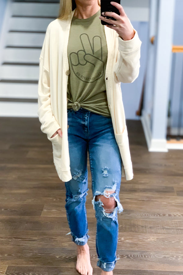 Who doesn't love wearing their boyfriend's cardigan?  Our Oversized Boyfriend Fit Cardigan by Vintage Havana will have you feeling cozy and comfy all day long!  This cardigan is so soft and features front pockets and button closure.  Perfect for pairing over your favorite graphic tee and distressed denim.