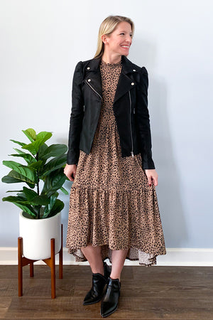 Look cute this fall in our Animal Print High Low Midi Dress!  This mocha colored dress features a keyhole back closure, boat neck with ruffle details, and a flowy relaxed fit.  This dress has a high-low hem which the front hits below the knees.  Perfect for pairing with booties and our Puff Sleeve Faux Leather Jacket.