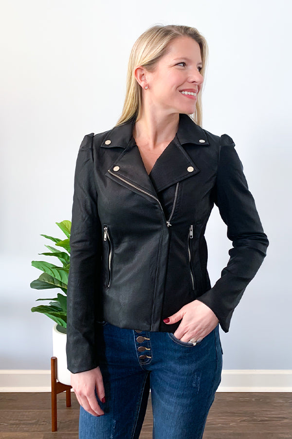 Our Puff Sleeve Faux Leather Jacket by Vintage Havana is a staple piece you need this season!  This moto style jacket features cute puff sleeves, off center zip closure, and front zip pockets. The side panels are a stretchy ribbed material that allows for a little bit of stretch throughout the arms and sides.  Add a little bit of edge to your outfit while keeping a femme-touch!