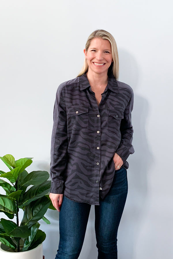 We love animal prints and totally digging this Vintage Havana Zebra Print Button Up Top! This super soft, tencel top features a trendy slate colored zebra print, button closure, and a unique contrast lining down both sleeves.  Perfect for pairing with your favorite pair of jeans!