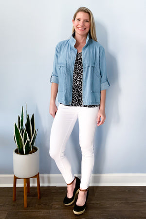 The perfect jacket for spring and summery is here!  The Washed Chambray Roll Tab Jacket is lightweight and features front pockets, roll tab sleeves, and front zip closure.  This chambray jacket has a tie waistband so you can tighten or loosen for a different look.  Perfect for pairing with a cami.