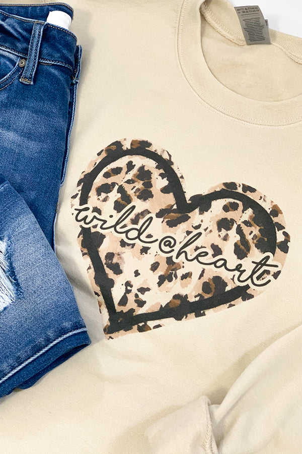 For the wild at heart, this Wild At Heart Leopard Sweatshirt was made for you!  Cozy, long sleeve sweatshirt with leopard print heart and Wild @ Heart graphics.  Pair with jeans and sneakers or pair with faux leather leggings and booties for an edgier outfit.  Details  Wild @ Heart Graphic Sweatshirt Leopard Print Graphic Long Sleeve True To Size Fabric: 50% Cotton / 50% Polyester