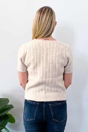 We are loving our Short Sleeve Sweater With Scalloped Detail!  This short sleeve sweater features a thick, soft fabric that will keep you cozy through fall and winter!  The scalloped detail and subtle blush color give this top a cute feminine touch that will leave you feeling beautiful.  This top's length meets at the natural waistline and is perfect for pairing with your favorite high-rise jeans and booties.