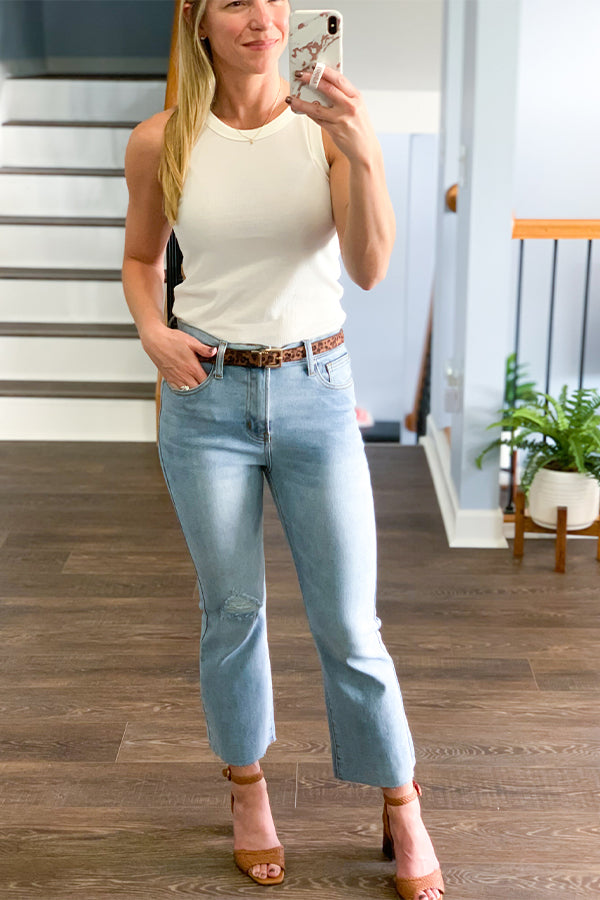 Look amazing this season with our Light Wash Demi Boot Raw Hem Crop Jeans.  We're loving these high waisted stretchy jeans featuring raw cropped hems, cute bootcut style, and classic 5-pocket.  These jeans are seriously the cutest! Easy to pair with sneakers or dress up with heels! Wishlist Jeans