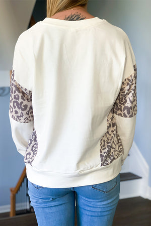 We are obsessed with our Leopard Detail Sweatshirt!  This CUTE sweatshirt is made with a super soft, stretchy fabric and features a relaxed fit, v-neckline, and ribbed cuffs, neck, and hem.  The leopard detail wraps around the arms and side of sweatshirt to give a unique look.  Pair with your favorite distressed denim to complete the look.