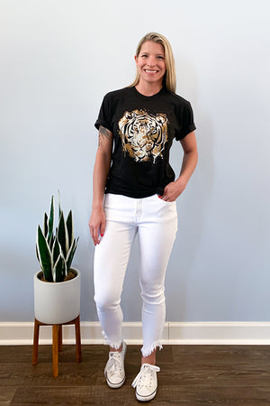 Stay fierce and comfy in our Tiger Graphic Tee.  This soft tee features a trendy tiger over a heather black, soft and stretchy short sleeve tee. Style it with a knot and paired with your favorite boyfriend jeans or high waist skinny jeans. If looking for a more relaxed outfit, pair with some cute joggers for an ultra comfy outfit.