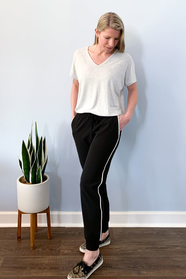 Dex By Black Tape Joggers. The Black Joggers With White Piping Detail features side pockets, white piping detail down both sides, and an elastic waistband and cuffs.  We are loving the versatility of these joggers.  Dress them up with a blouse and a pair of heels for an office outfit or pair with a casual tee and sneakers for a comfy casual outfit.