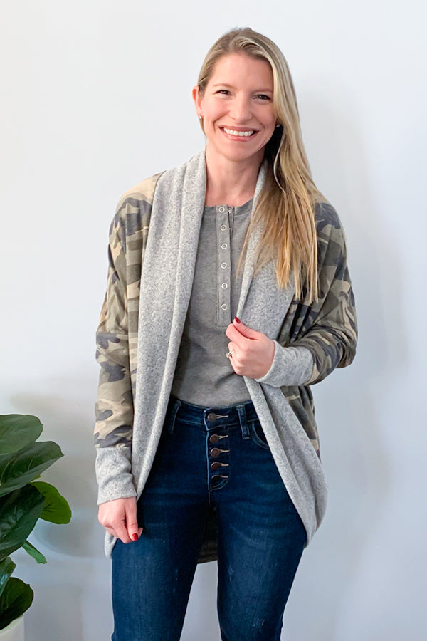 Love camo? Then you'll love this cardigan! The Camo Cocoon Cardigan features dolman long sleeves, open contrast trim and cuffs, and cocoon hemline.  Pair with a henley bodysuit and skinny jeans to complete the look.