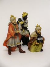"Three of the 15 hand-painted figurines included in the Nativity Scene. Three Kings Bearing Gifts. Polyresin Christmas Nativity Scene figurines, up to 4"" tall."