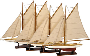 Set of four model sailboats