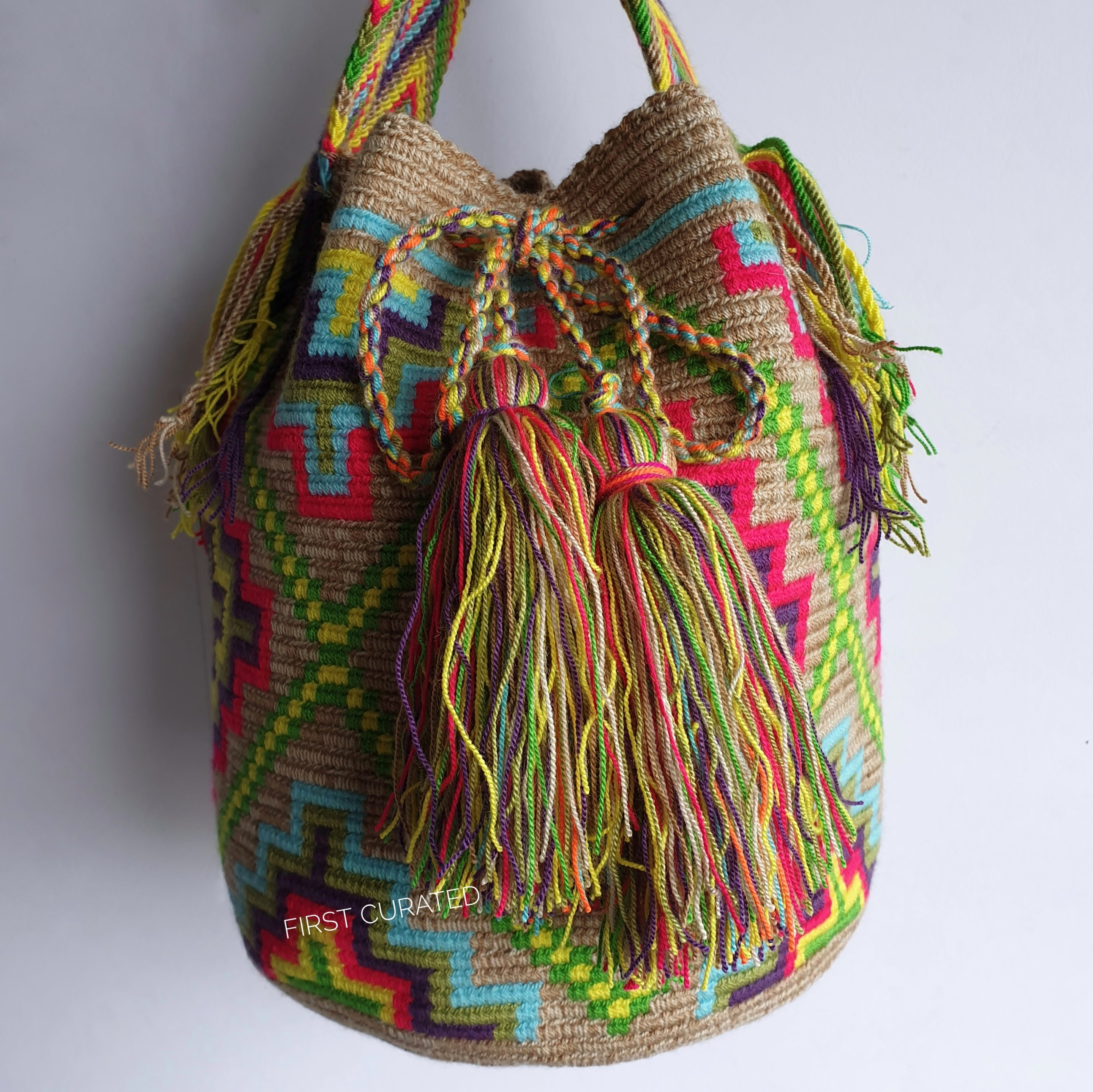 Waayu Bucket Sling Bag with Bright Accent Colors