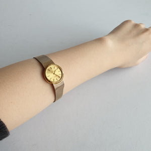 Omega Gold Round Watch