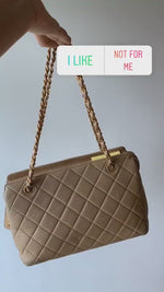 Load and play video in Gallery viewer, Chanel Beige Quilted Zippered Purse