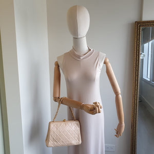 Chanel Pale Pink Handbag with Round Clasp