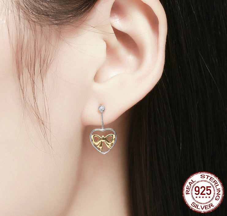 Bond of Hearts - Glowing Bow in the Heart Earrings with Diamonds like Crystals, Crafted from Silver