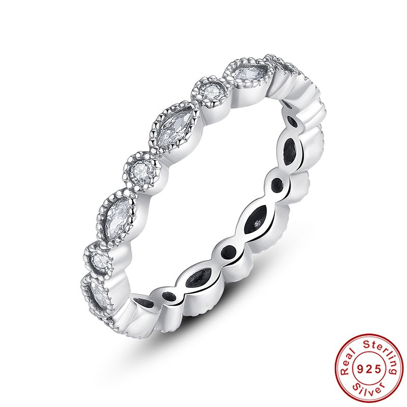 Elegant Finger Ring with a String of Leaves and Circles Crafted from Silver