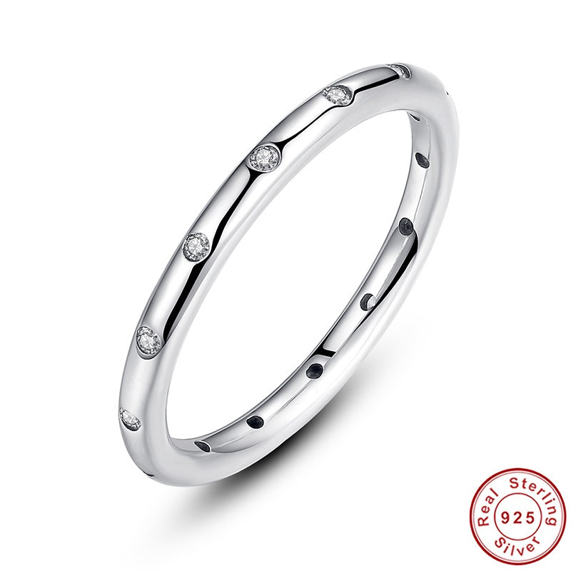 Simple yet Cute Finger Ring for Women Crafted from Silver and Paved with Crystals