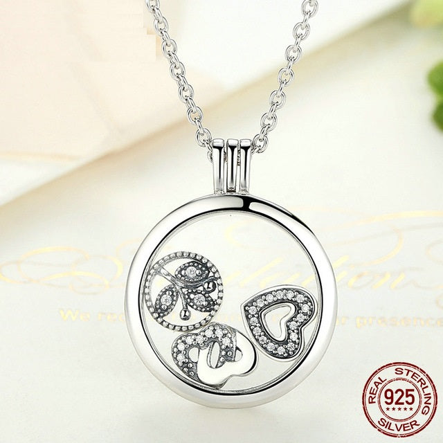 Wear multiple designs with this cute floating pendant necklace made wear multiple designs with this cute floating pendant necklace made from silver and elegant crystals solutioingenieria Image collections