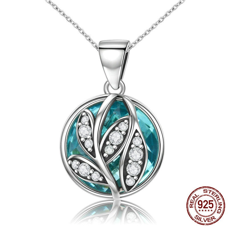 Gorgeous Pendant Necklace with Leaves Paved with Diamonds like Crystals on a Elegant Blue Crystal