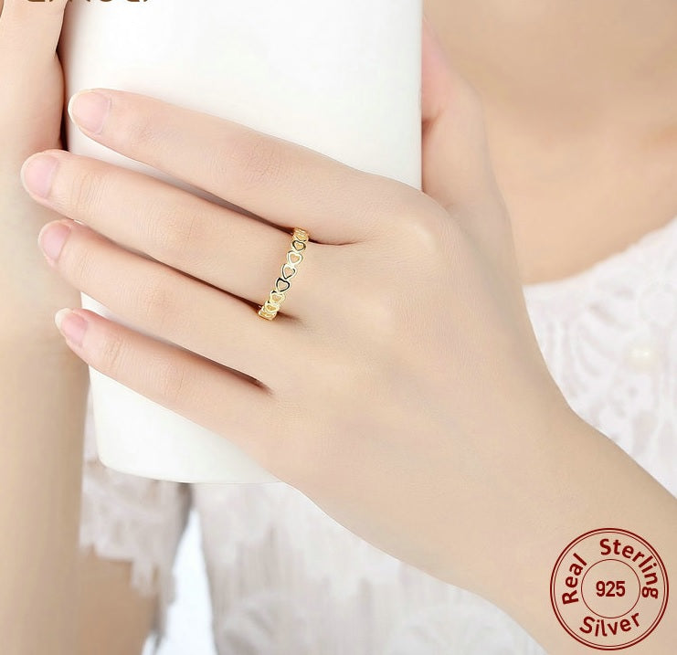 Women's Elegant Finger Ring with A String of Hollowed Out Hearts, Crafted from gold Plated Silver