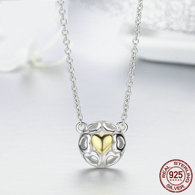 Designer Pendant Necklace with one Golden Heart surrounded with silver hollowed out Hearts