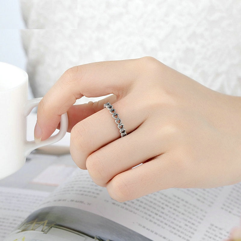 Women's Romantic Finger Ring with A String of Hollowed Out Crystals Paved Hearts