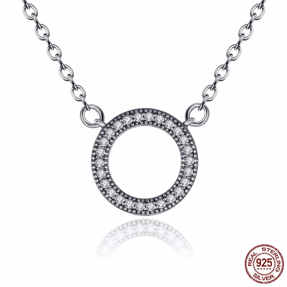 Simple but elegant silver necklace with circular pendant paved with simple but elegant silver necklace with circular pendant paved with diamonds like crystals aloadofball Images