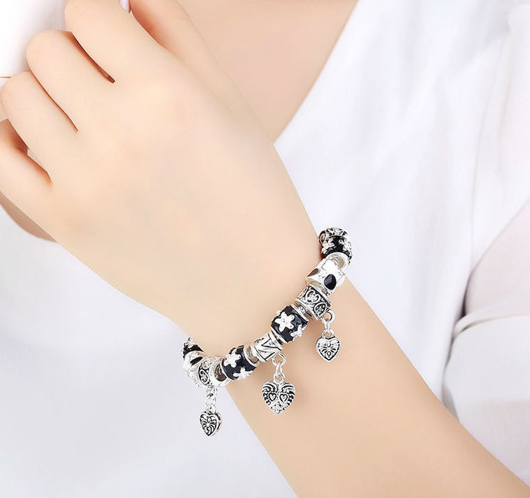 Beauty of Black & Silver - Simply Gorgeous Bracelet for Women with 3 Heart Pendants