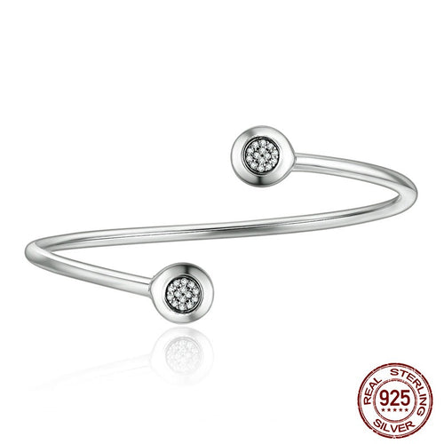 Bangle Crafted from Silver and the Round Ends Paved with  Crystals