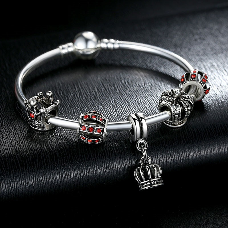 Elegant Charm Bracelet with the Energy of Red and Power of the Crown