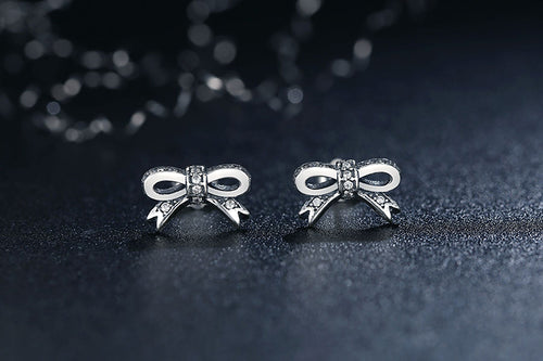Feel Cute - Sparkling Bow Stud Earrings Crafted from Silver and Paved with Crystals