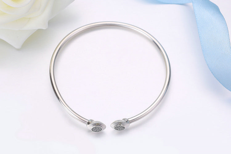 Elegant Open Ends Bangle Crafted from Silver and the Round Ends Paved with Diamonds like Crystals