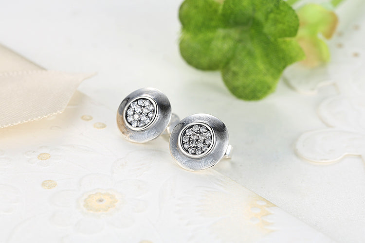 Elegance of Diamonds - Round Stud Earrings Crafted from Silver and Crystals