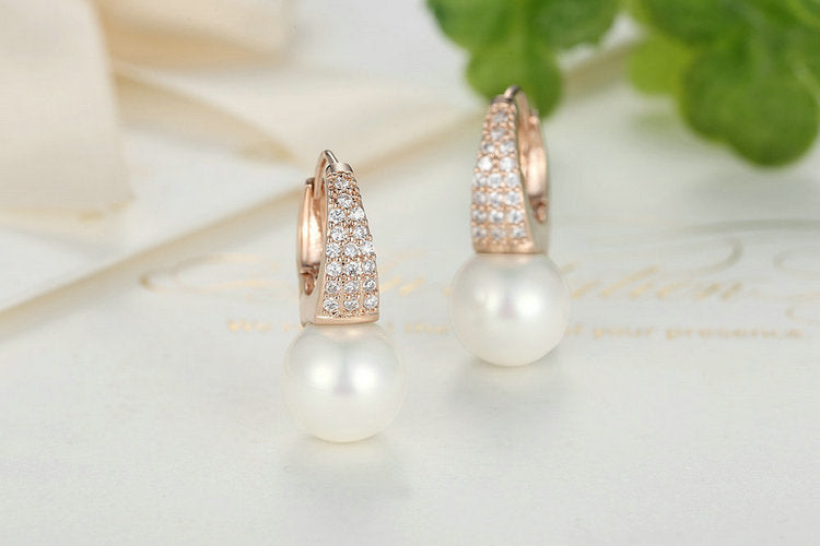 Elegance of Diamonds and Peace of Pearls - Rose Gold Plated Elegant Earrings for Women with Simulated Pearls &  Clear Crystals