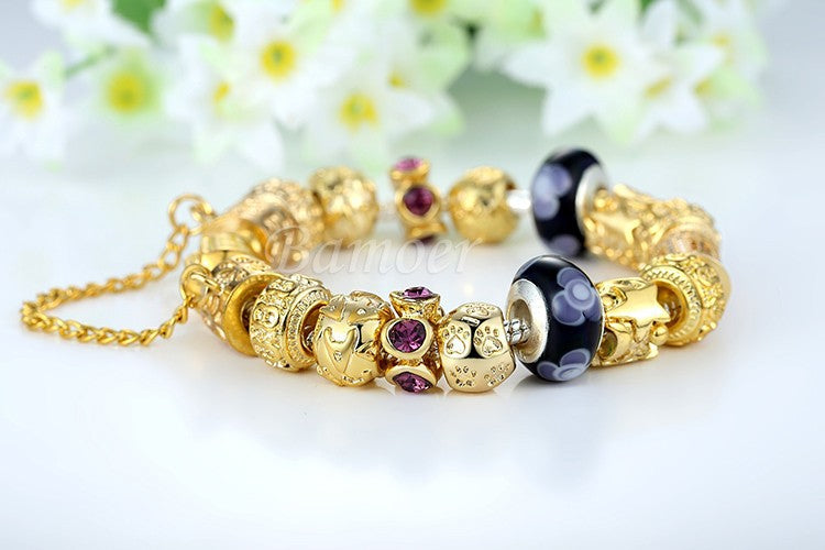 Women's Eye Catching Luxurious and Gorgeous Charm Bracelet with Two Floral Black Beads and a Hanging Chain