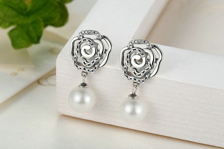 Elegant Floral Earrings with an Abstract Rose, Crafted from Silver and Crystals and Pearls