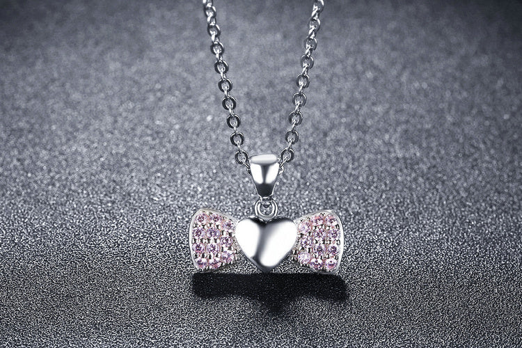 Women's Wings of Heart Pendant Necklace. Crafted from Silver and Elegant Pink Crystals