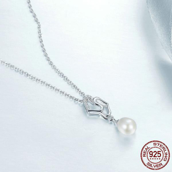 Lovely Pair of Hearts with a Hanging Pearl - Beautiful Pendant Necklace Crafted from Silver and Diamonds like Crystals