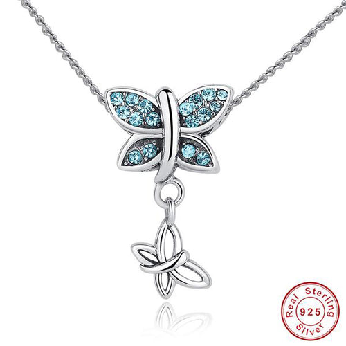 Elegant Butterfly Pendant Necklace Crafted from Silver and Blue Topaz like Crystals