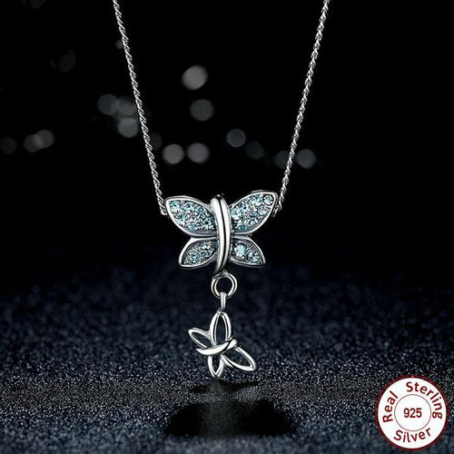 Pair of Butterflies - Elegant Pendant Necklace Crafted from Silver and Blue Topaz like Crystals